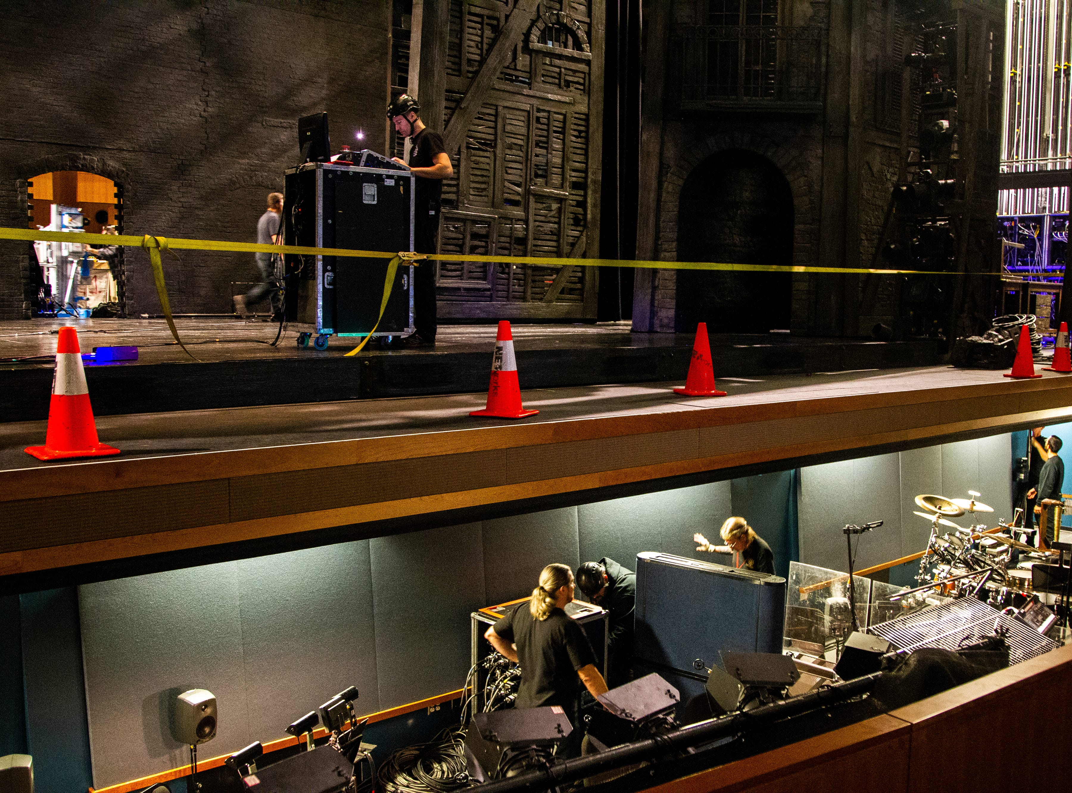 Members of the Les Misérables crew work in the pit before its opening show on Tuesday, Dec. 4, 2018, at Hancher Auditorium on the University of Iowa campus in Iowa City.