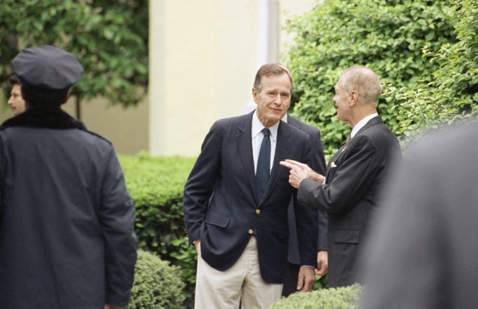 """In this May 10, 1992, file photo, President George H.W. Bush chats with Rep. G. V. """"Sonny"""" Montgomery, D-Miss., as he leaves services at St. John's Episcopal Church in Washington."""