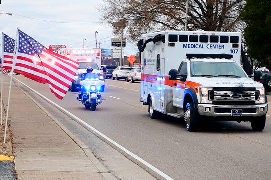 The body of US Army Veteran and Medical Center EMS Paramedic Zach Pruitt arrived at Englewood Baptist Church by police escort, Tuesday, December 4.