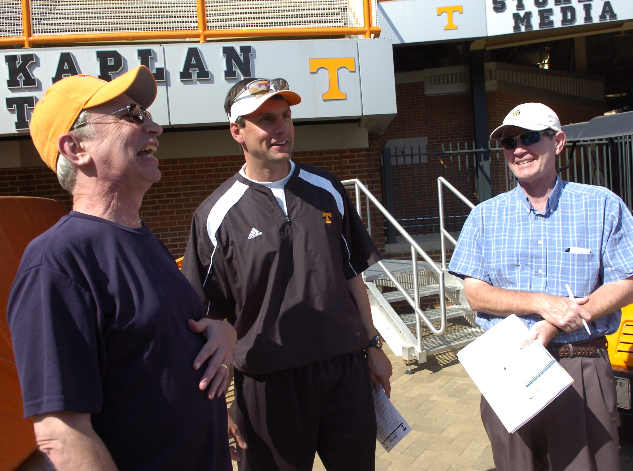 From left, KNS sportswriter John Adams with UT head coach Derek Dooley and Jimmy Hyams during practice at Neyland Stadium on April 15, 2010.