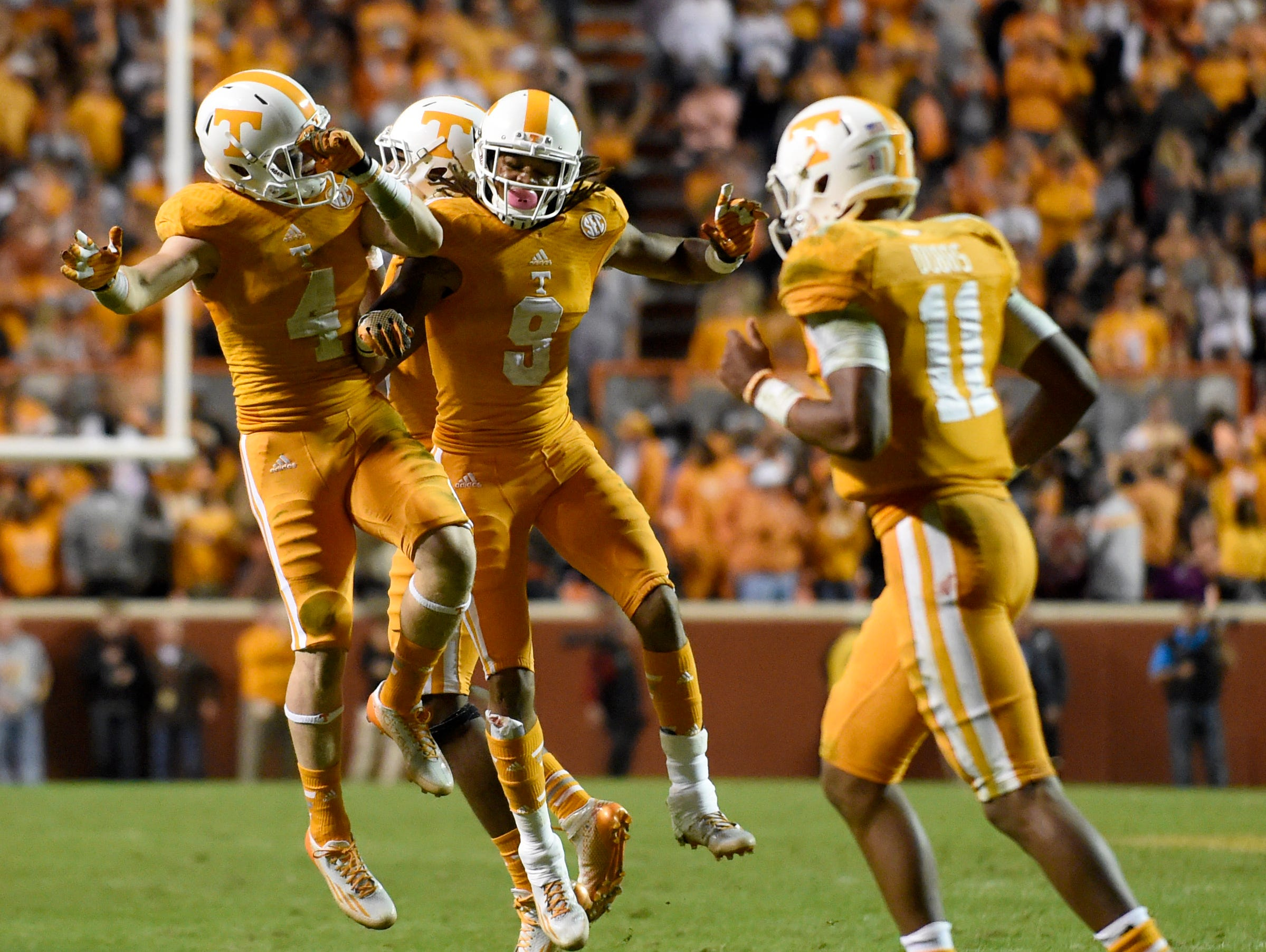 Tennessee wide receiver Von Pearson (9) celebrates his touchdown with Tennessee wide receiver Vic Wharton (4) during the second half at Neyland Stadium, Saturday, Oct.25, 2014 in Knoxville, Tenn.