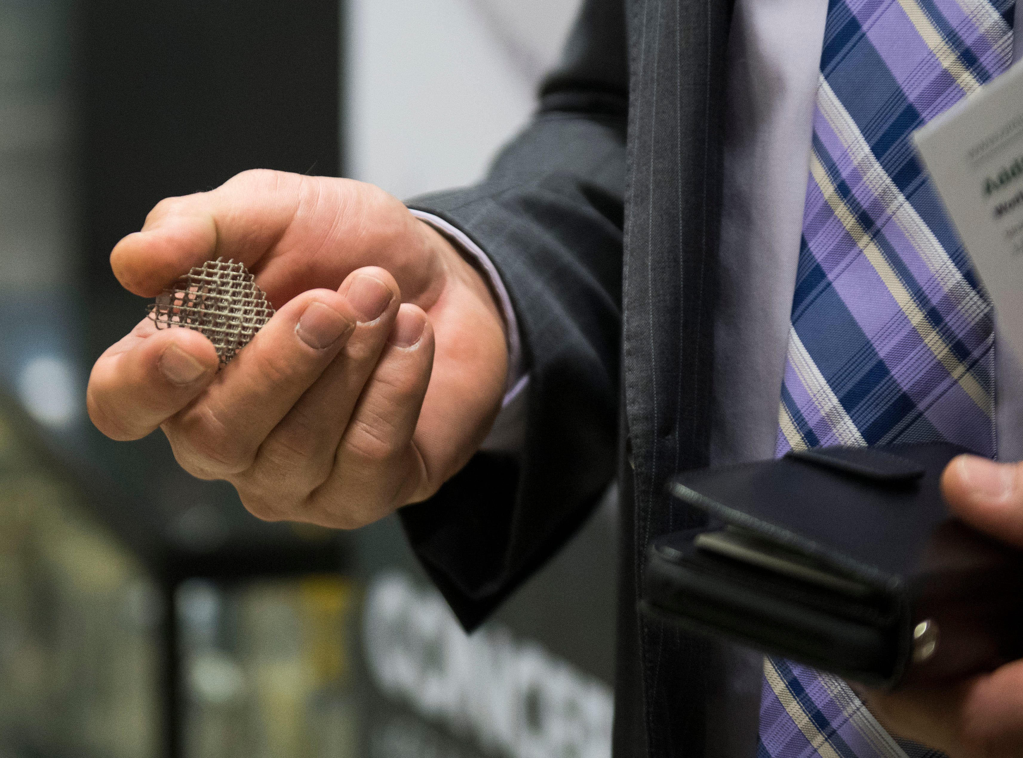 The Knox County Mayor Glenn Jacobs holds a 3d printed item at Oak Ridge National Laboratory's Manufacturing Demonstration Facility in Knoxville Tuesday, Dec. 4, 2018.