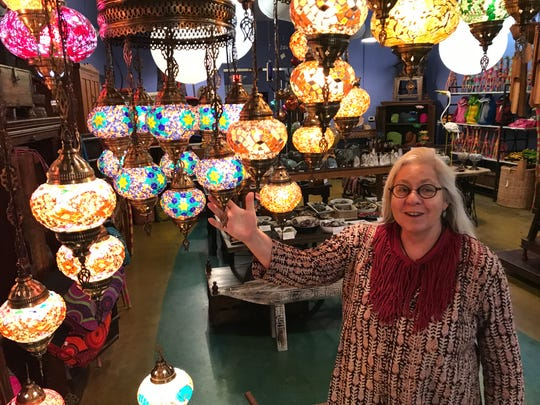 Handmade Turkish glass mosaic lamps and chandeliers start at $45 at international-goods store Agora on Market Square, shown off here by shopkeeper Liza Jane Alexander.