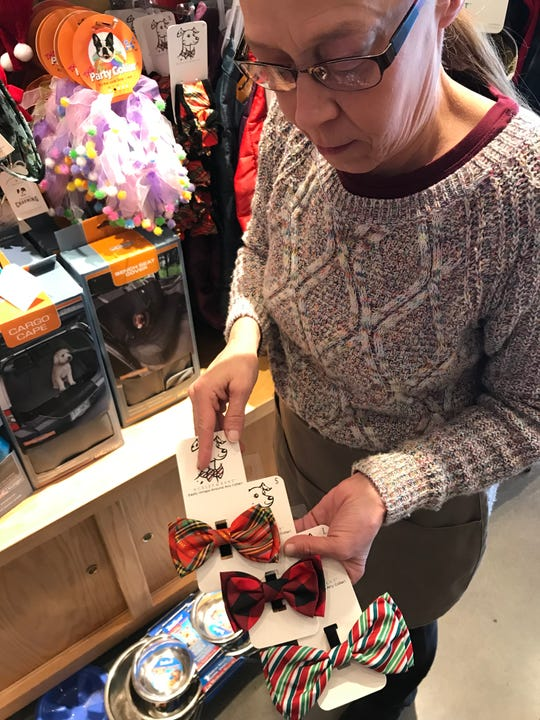 Pet bow ties start at $5.49 at Citifido Premium Pet Provisions on Union Avenue. Assistant Manager Deborah Strickland shows off their holiday colors.