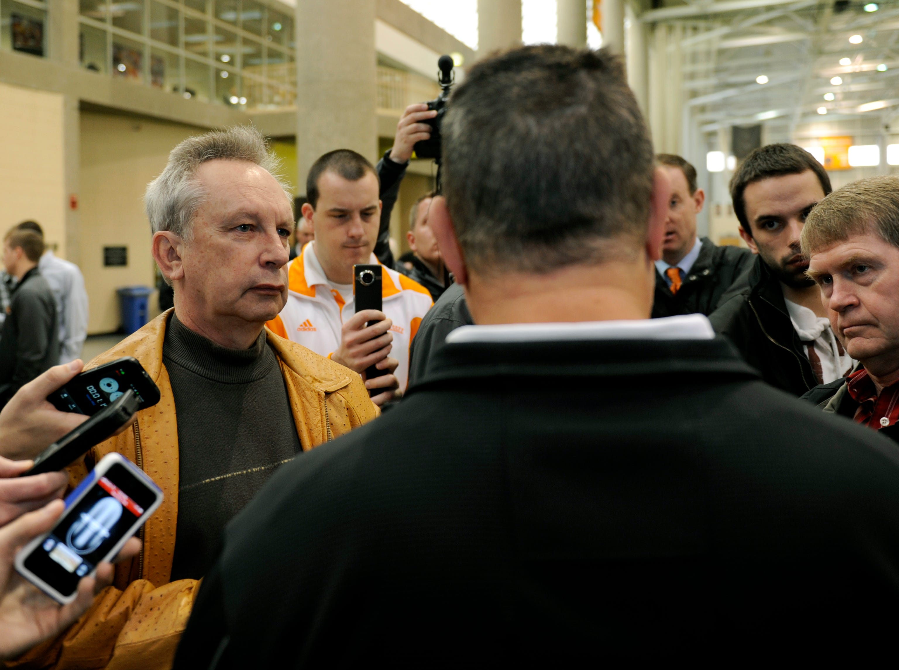 Knoxville News Sentinel sports reporter John Adams, left, and other media members during an interview with a UT assistant football coach Wednesday, Feb. 8, 2012 in the indoor practice facility on campus.