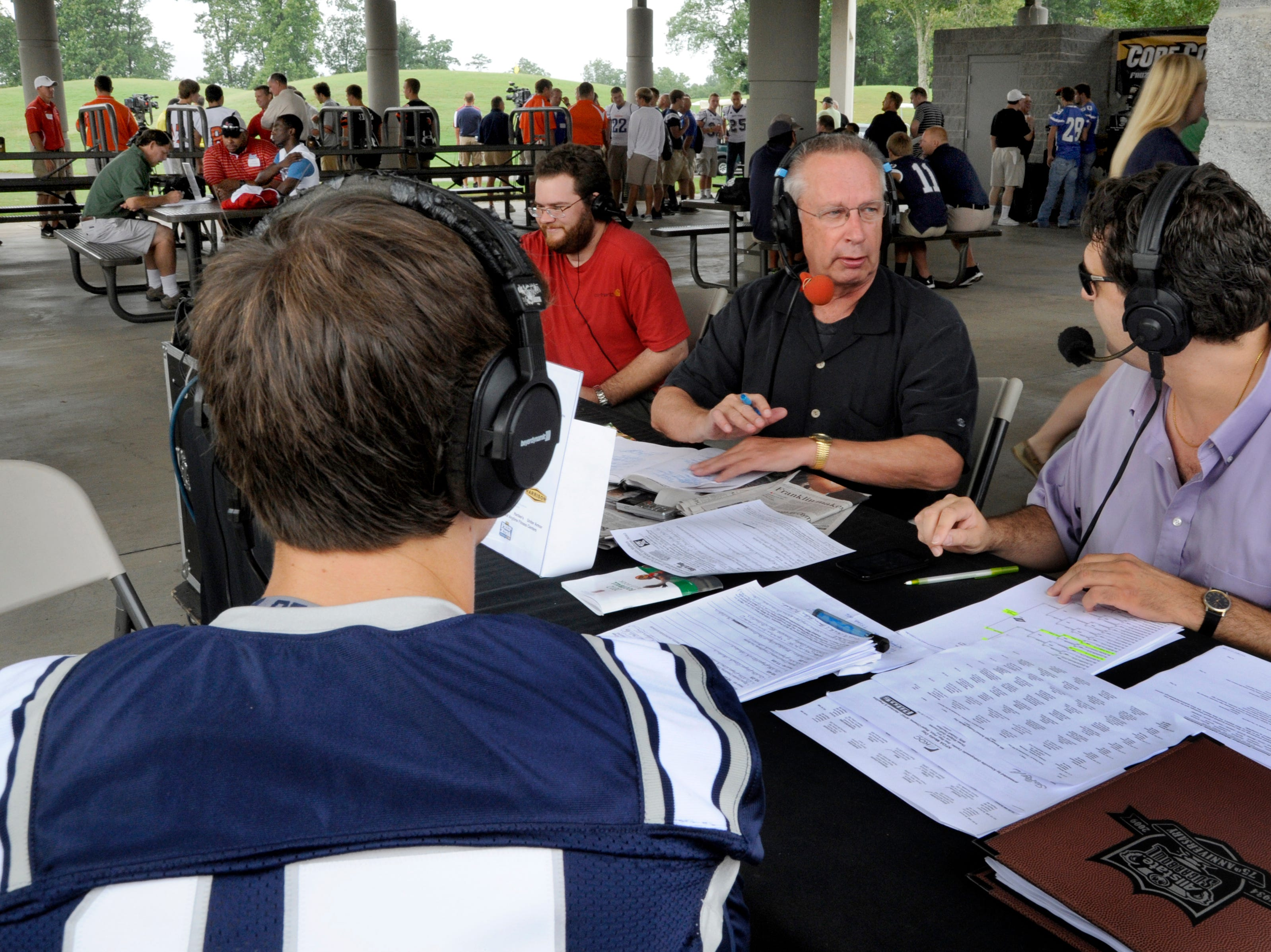 News Sentinel Sports Page hosts Vince Ferrara, right, and John Adams, center, interview Farragut quarterback Jonathan King during the 6th Annual High School Football Media Day on Friday, Jul. 13, 2012, at Three Ridges Golf Course.