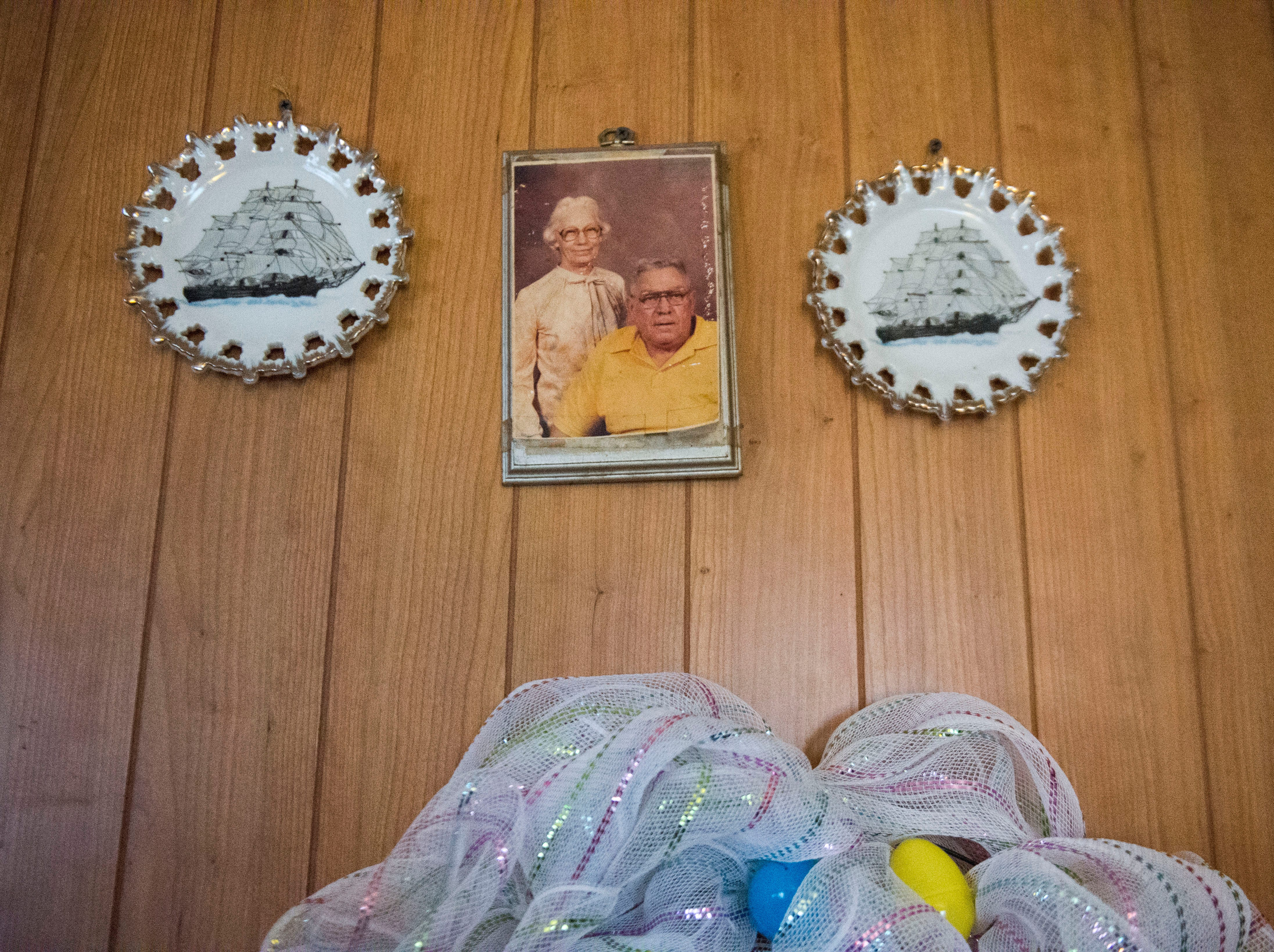 A photo of Mary Zick's late parents hangs on her wall in her Knoxville home Tuesday, Dec. 4, 2018. Zick receives dialysis 3 times per week, and the Milk Fund has provided her with Ensure the past 4 to 5 months.