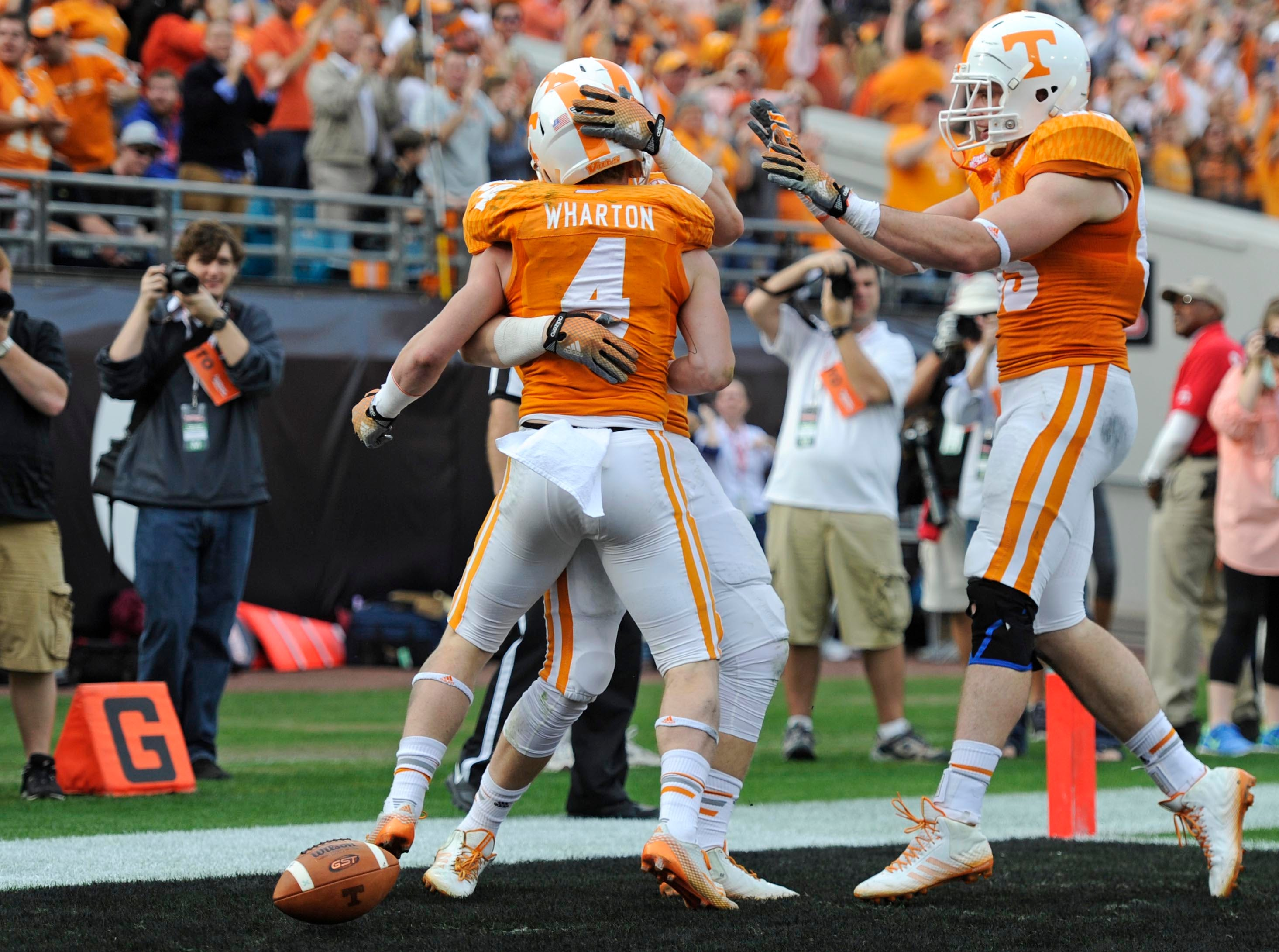 Tennessee wide receiver Vic Wharton (4) celebrates after scoring a touchdown against Iowa during the first half of the Taxslayer Bowl at EverBank Field on Friday, Jan. 2, 2015 in Jacksonville, Fla.