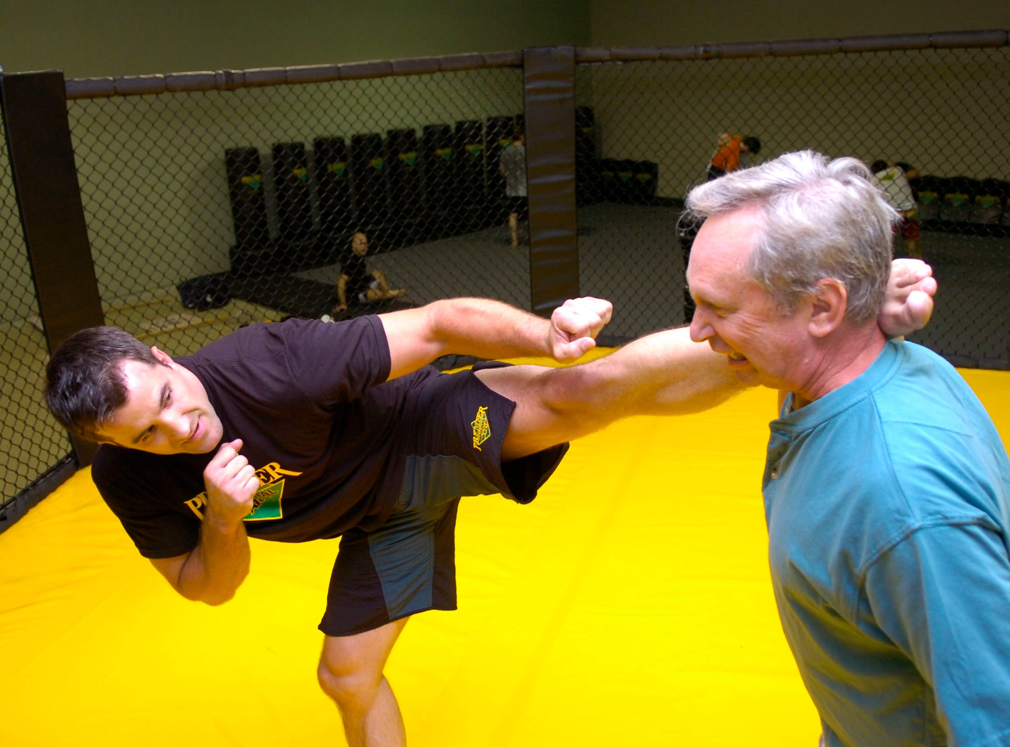 News Sentinel columnist John Adams is the target for martial arts fighter Terry Pollard on July 13, 2008.