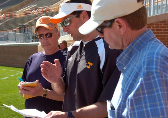 KNS sportswriter John Adams with UT head coach Derek Dooley and Jimmy Hyams during practice at Neyland Stadium on April 15, 2010.
