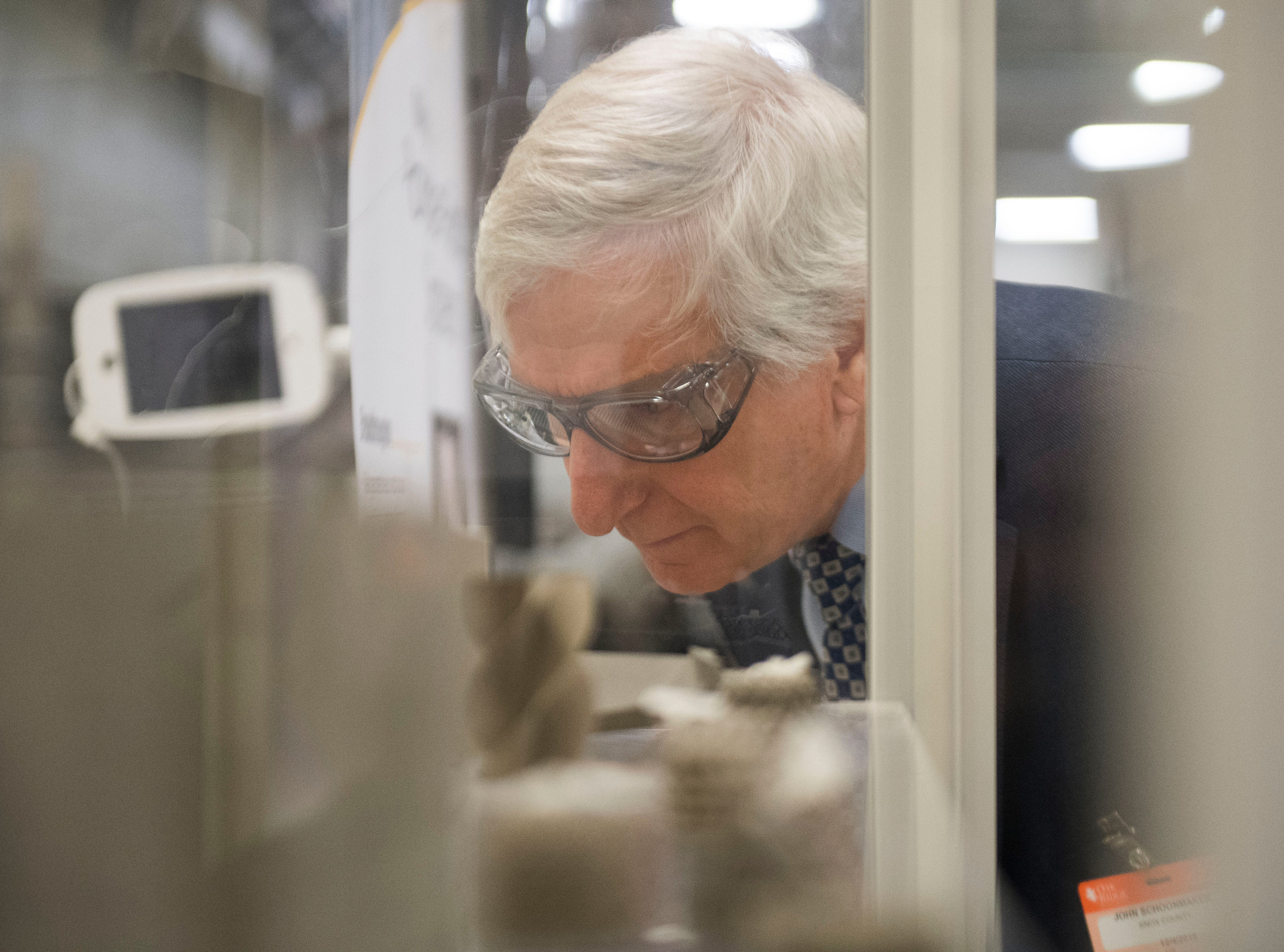 Knox County commisioner John Schoonmaker looks at 3d printed items during a tour of Oak Ridge National Laboratory's Manufacturing Demonstration Facility in Knoxville Tuesday, Dec. 4, 2018. The group got a sense of what is available for the region in terms of advanced manufacturing, and potential workforce initiatives.