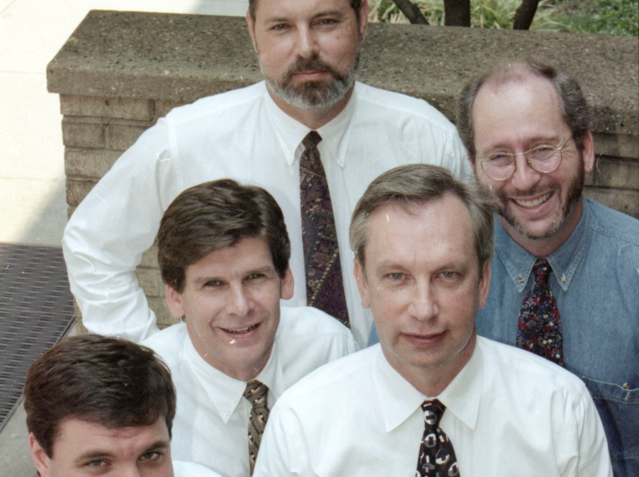 News Sentinel sports department in 2000. From left, Mike Griffith, Gary Lundy, Mike Strange, and Dan Fleser.