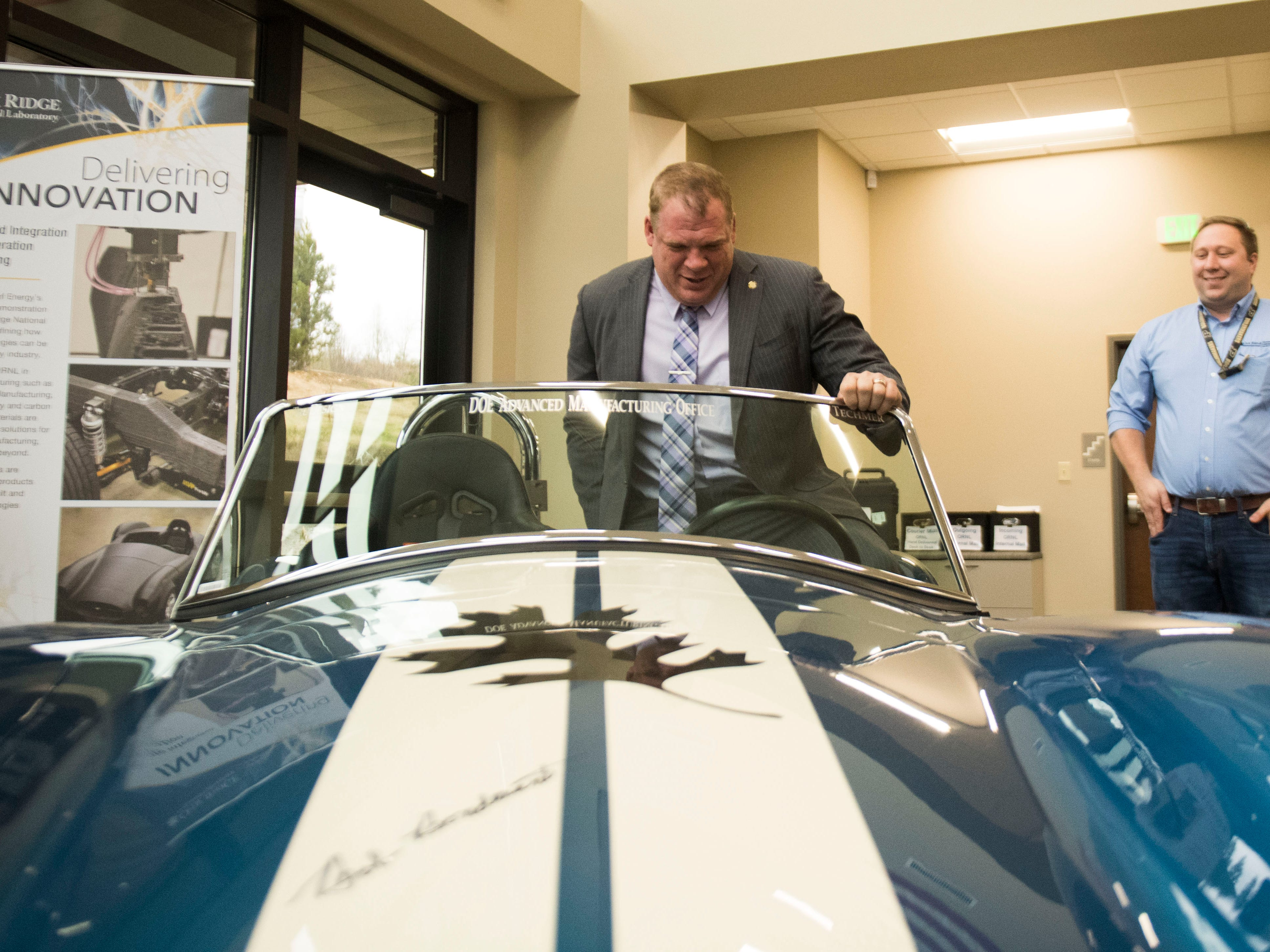 Knox County Mayor Glenn Jacobs sits in a 3d printed car at Oak Ridge National Laboratory's Manufacturing Demonstration Facility in Knoxville Tuesday, Dec. 4, 2018. The group of Knox County Commissioners and Knoxville Chamber officials got a sense of what is available for the region in terms of advanced manufacturing, and potential workforce initiatives.