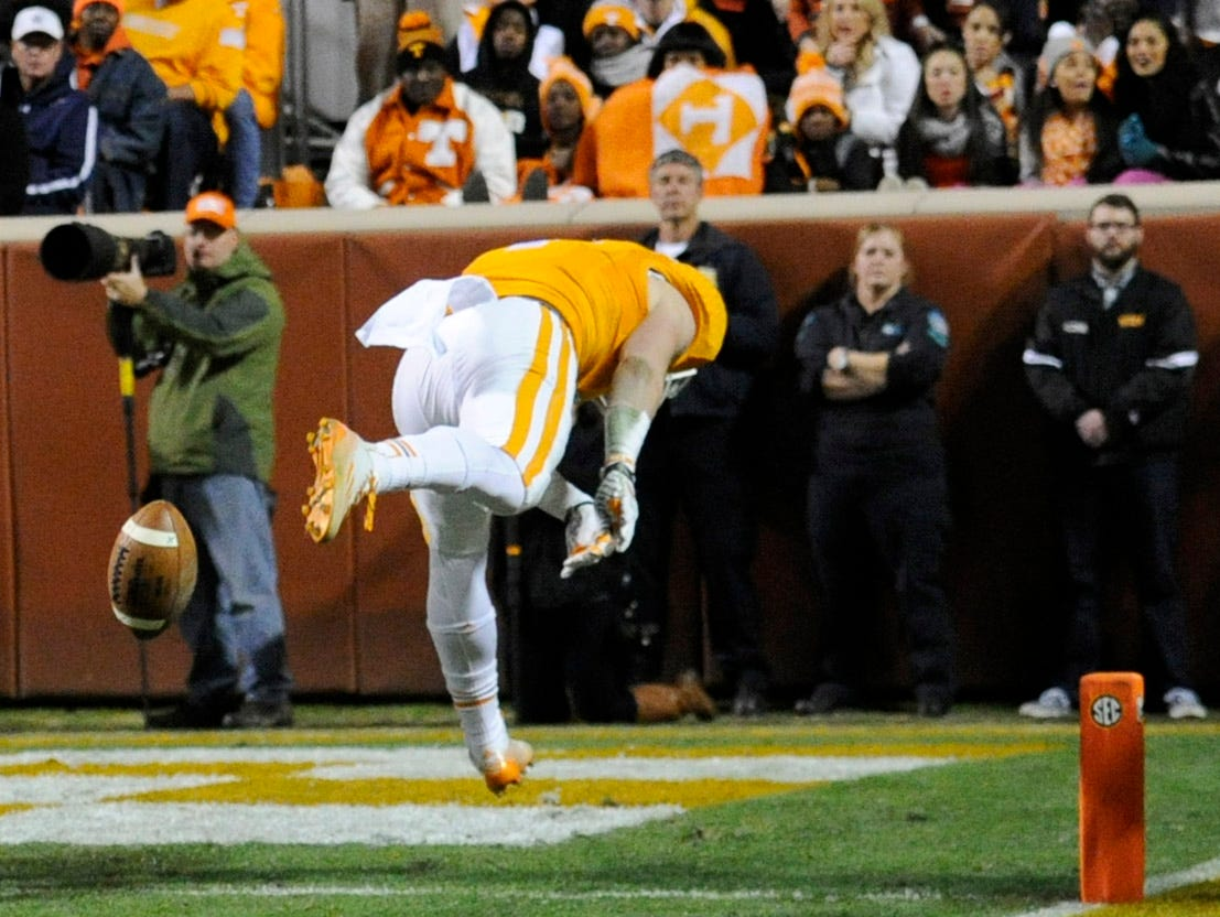 Tennessee wide receiver Vic Wharton (4) keeps the ball from landing in the end zone on a kick against Missouri during the first half at Neyland Stadium on Saturday, Nov. 22, 2014 in Knoxville, Tenn.