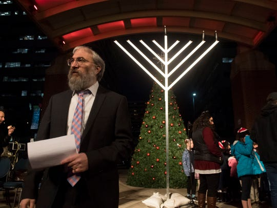 Rabbi Yossi Wilhelm lead the ceremony during Knoxville's first Chanukah in the City was at Market Square on Monday, December 3, 2018.