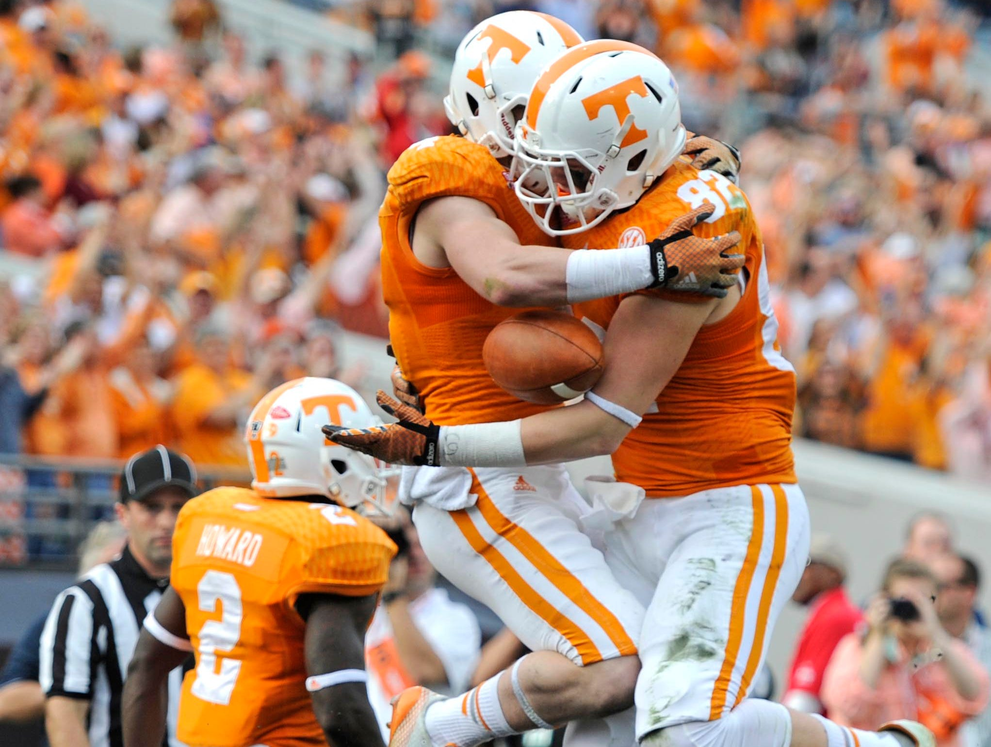 Tennessee wide receiver Vic Wharton (4) and Tennessee tight end Ethan Wolf (82) celebrate after Wharton scored a touchdown against Iowa during the first half of the Taxslayer Bowl at EverBank Field on Friday, Jan. 2, 2015 in Jacksonville, Fla.
