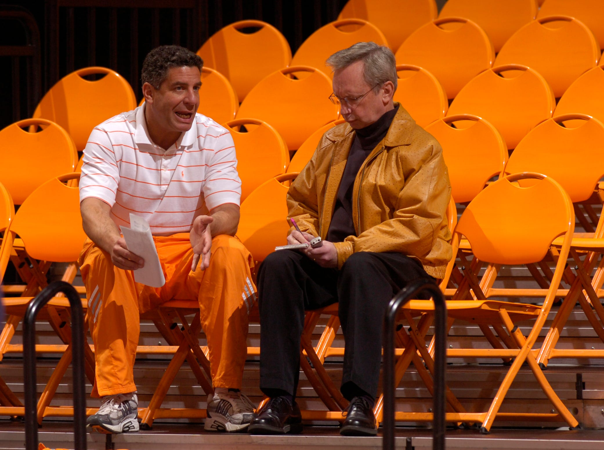 Tennessee men's basketball coach Bruce Pearl, left, talks with News Sentinel sports editor John Adams Monday, Dec. 19, 2005, at Thompson-Boling Arena.