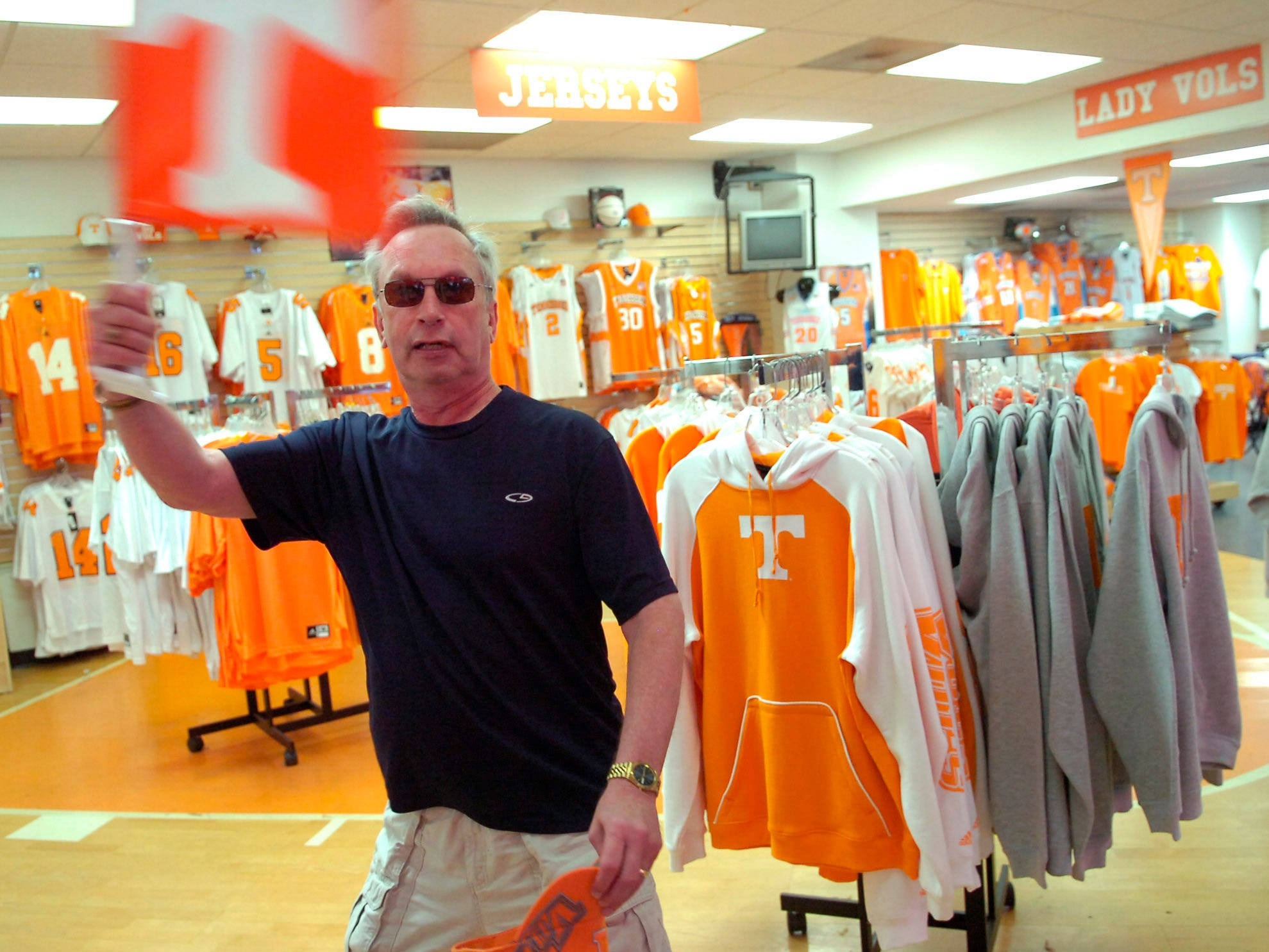 KNS sportswriter John Adams shops for his celebrity coaching gear on April 15, 2010. Adams with coach the orange team on Saturday at the Orange and White game.