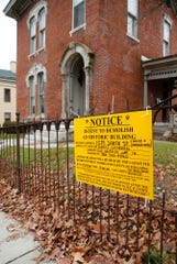 An historic home at 1014 South Street Tuesday, December 4, 2018, in Lafayette. Leaders from St. Mary Cathedral, located across the street, would like to demolish the historic home to make way for a new rectory.