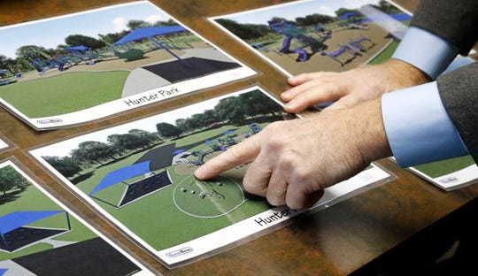 Lancaster Parks and Recreation Superintendent Mike Tharp Jr. points to an artist rendering of what the new Hunter Park could look like when fully accessible playground equipment is installed next year.