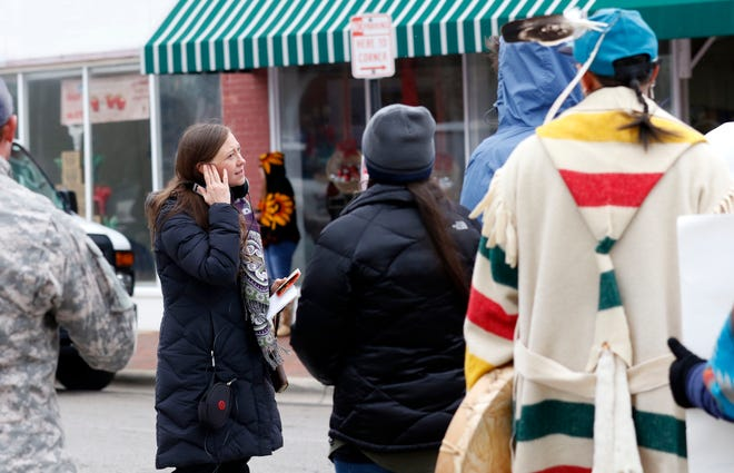"""Rebecca Harrell Tickell, co-director, co-producer and co-writer of film """"Heartland,"""" talks to extras on the set of the film Tuesday morning, Dec. 4, 2018, at the intersection of South Columbus and West Chestnut Street in downtown Lancaster."""