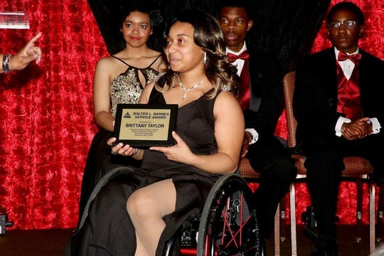 Brittany Taylor receives the Walter L. Barnes Service Award