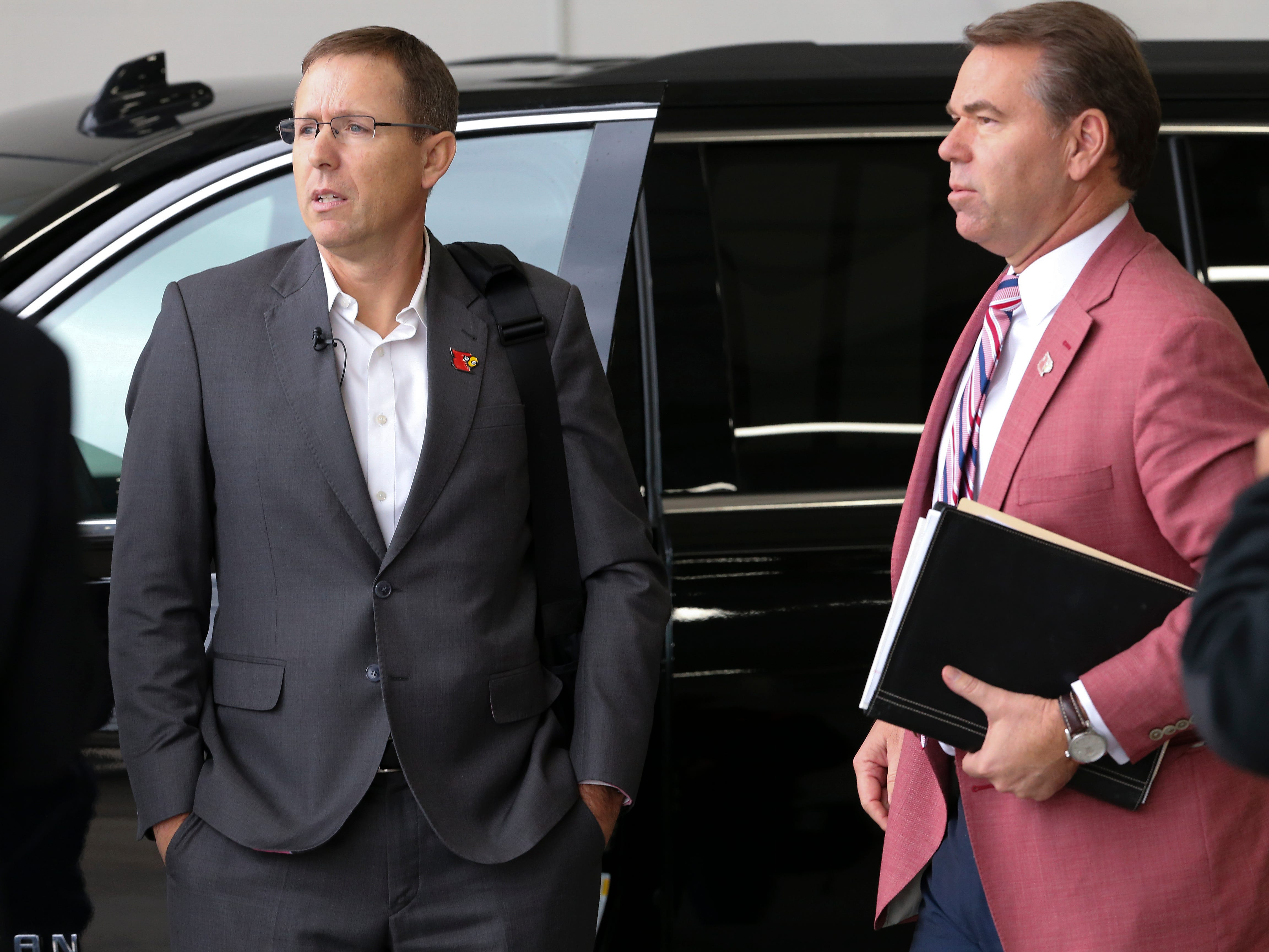 Appalachian State head football coach Scott Satterfield, left, waits inside an airport hangar with U of L athletic director Vince Tyra after exiting a private plane in Louisville.  Satterfield expects to be named the new head football coach at U of L.  Dec. 4, 2018