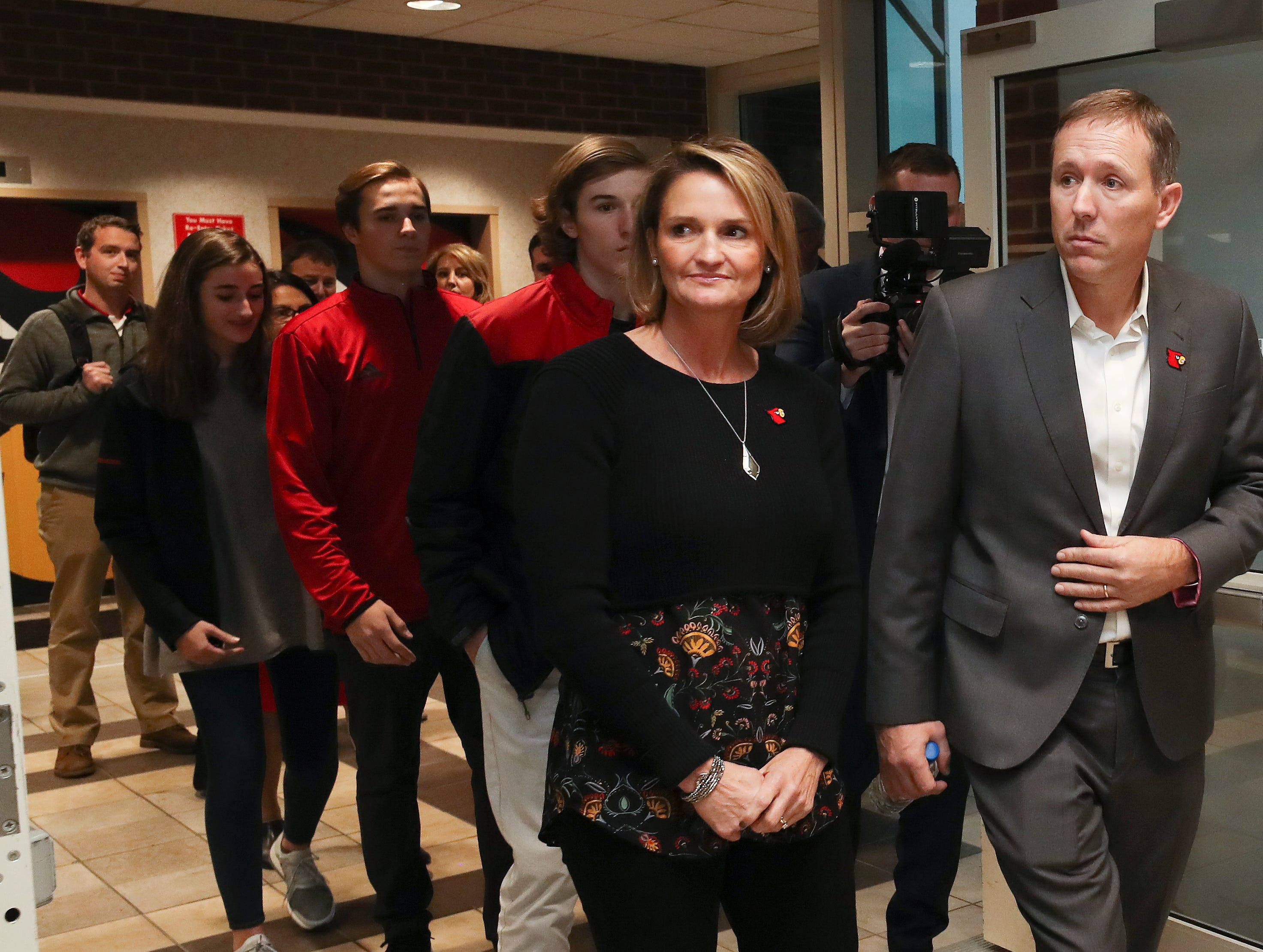 New U of L head football coach Scott Satterfield, right, walks into the annoucement of his new position with his wife Beth at Cardinal Stadium.  Dec. 4, 2018
