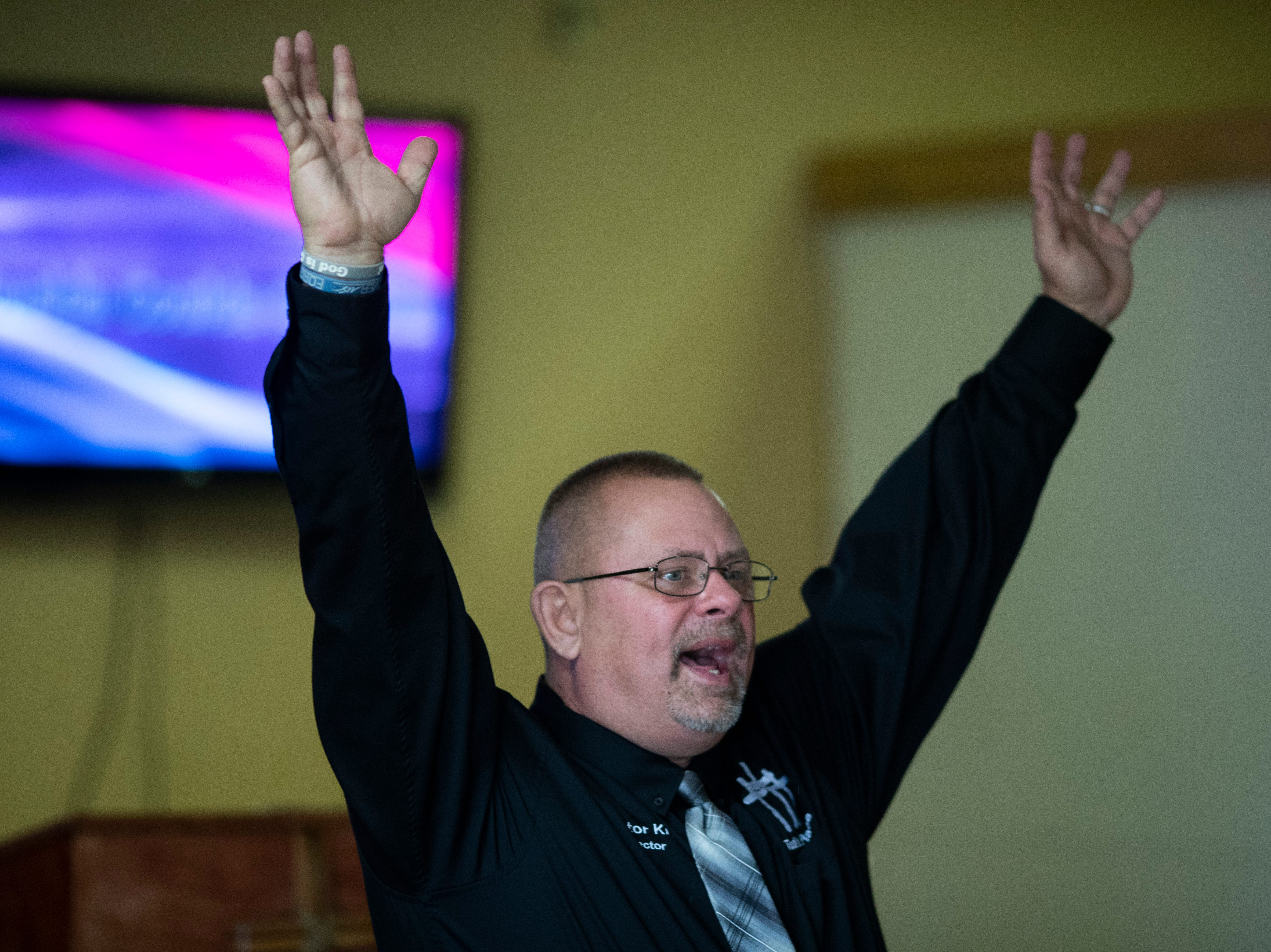 "Todd's Place Transitional Housing founder and pastor Kris Hunley preaches a Sunday service at the inpatient recovery center in Seymour, Indiana. ""You can't find a person in this building that I haven't been high with, or in jail with,"" Hunley said. ""It's our goal here to make them leaders again."" Dec. 2, 2018"