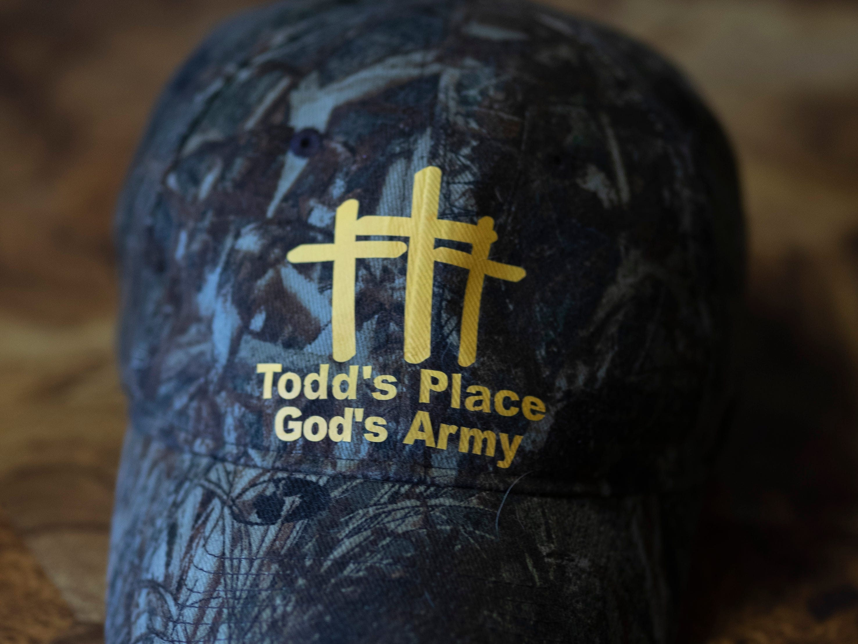 A Todd's Place Transitional Housing hat sits on a table inside the recovery center in Seymour, Indiana. Dec. 2, 2018