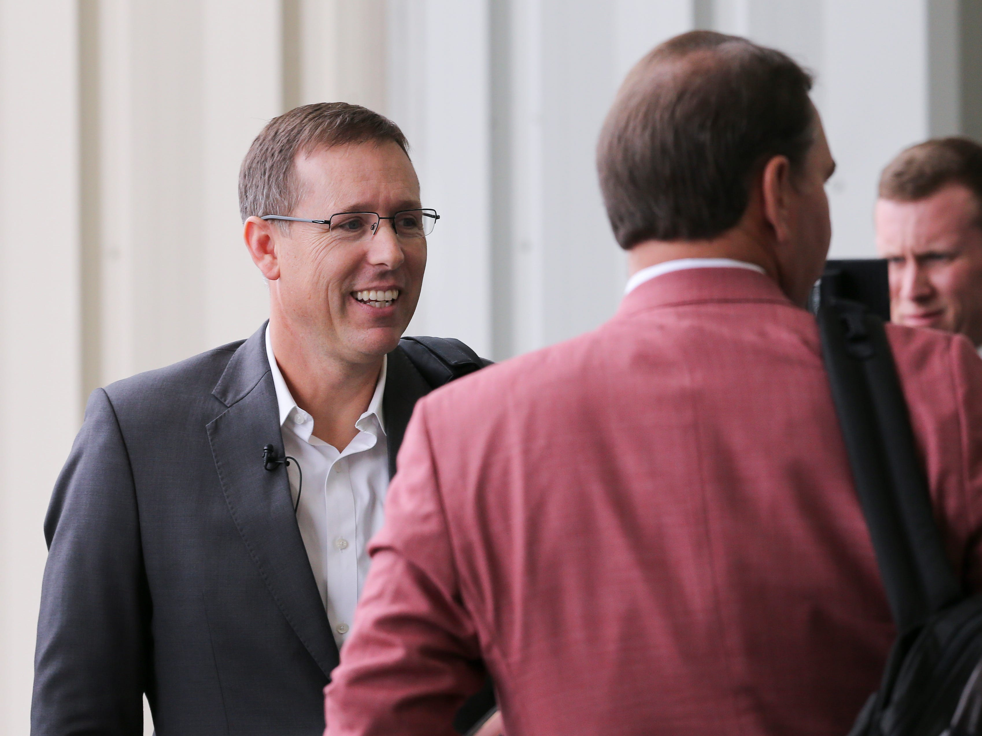 Appalachian State head football coach Scott Satterfield, left, chats briefly with U of L athletic director Vince Tyra after exiting a private plane in Louisville.  Satterfield expects to be named the new head football coach at U of L.  Dec. 4, 2018