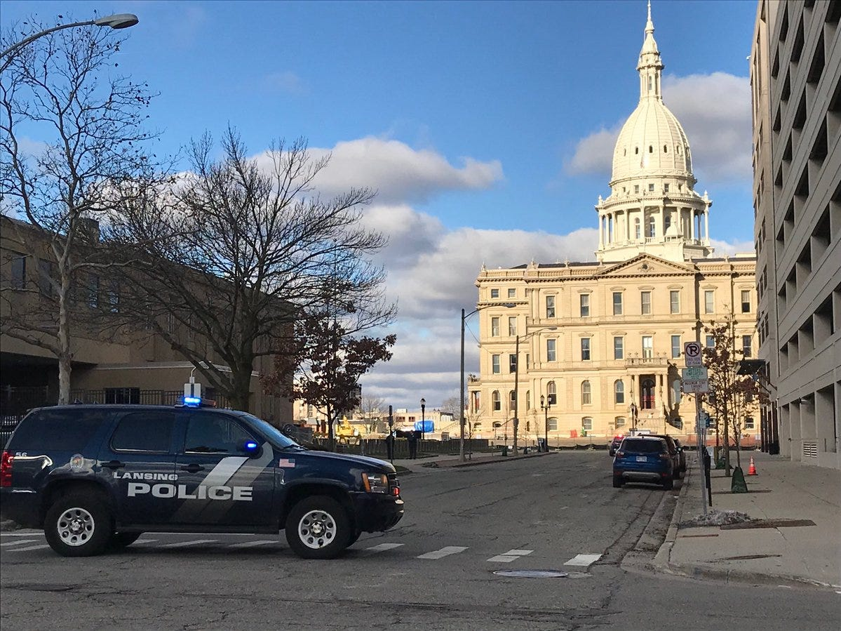 Police have a one-block perimeter shut off around the state Capitol building on Tuesday, Dec. 4, 2018.
