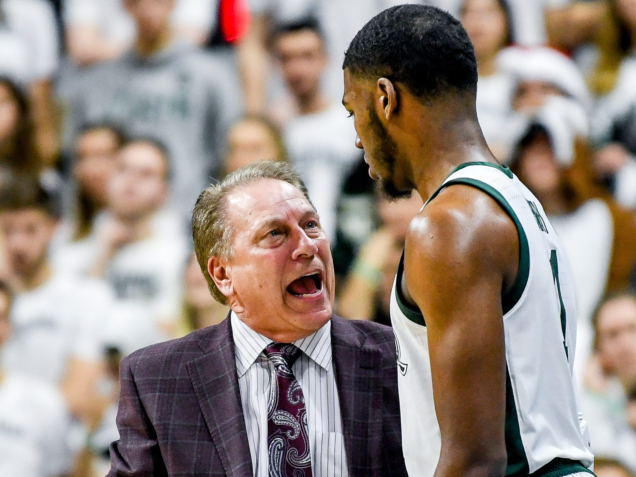 Michigan State head coach Tom Izzo, left, talks with Aaron Henry during the second half on Monday, Dec. 3, 2018, at the Breslin Center in East Lansing. Michigan State beat Iowa 90-68.