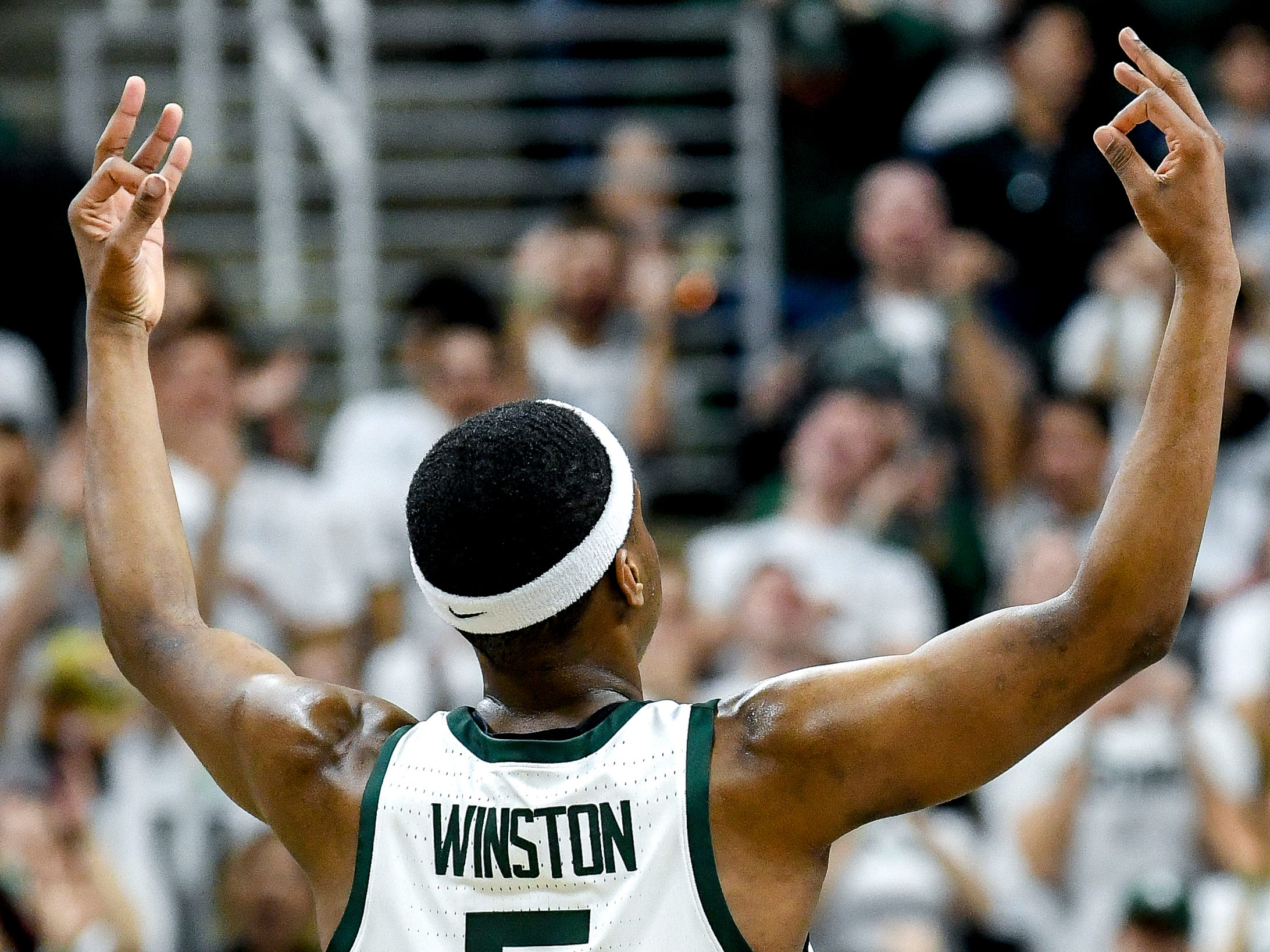 Michigan State's Cassius Winston celebrates after making a 3-poiner during the first half on Monday, Dec. 3, 2018, at the Breslin Center in East Lansing.