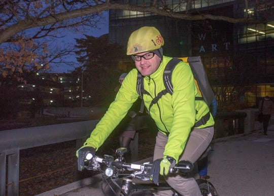 Thomas Baumann of East Lansing, leaves MSU's campus Monday, Dec 3, 2018 for his commute home from work. Baumann commutes to MSU via bicycle all year.
