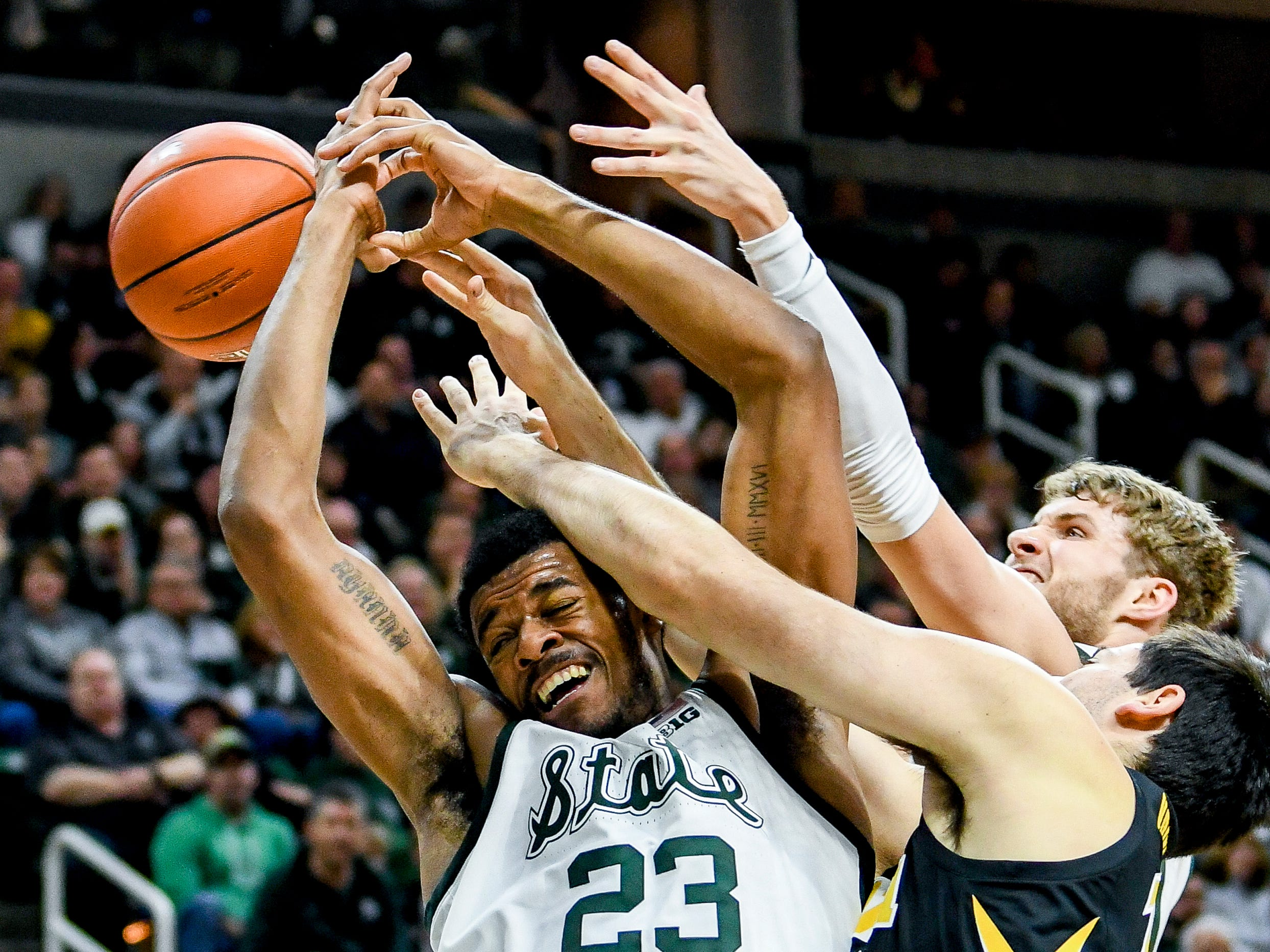 Michigan State's Xavier Tillman, left, battles Iowa's Ryan Kriener for a rebound during the first half on Monday, Dec. 3, 2018, at the Breslin Center in East Lansing.