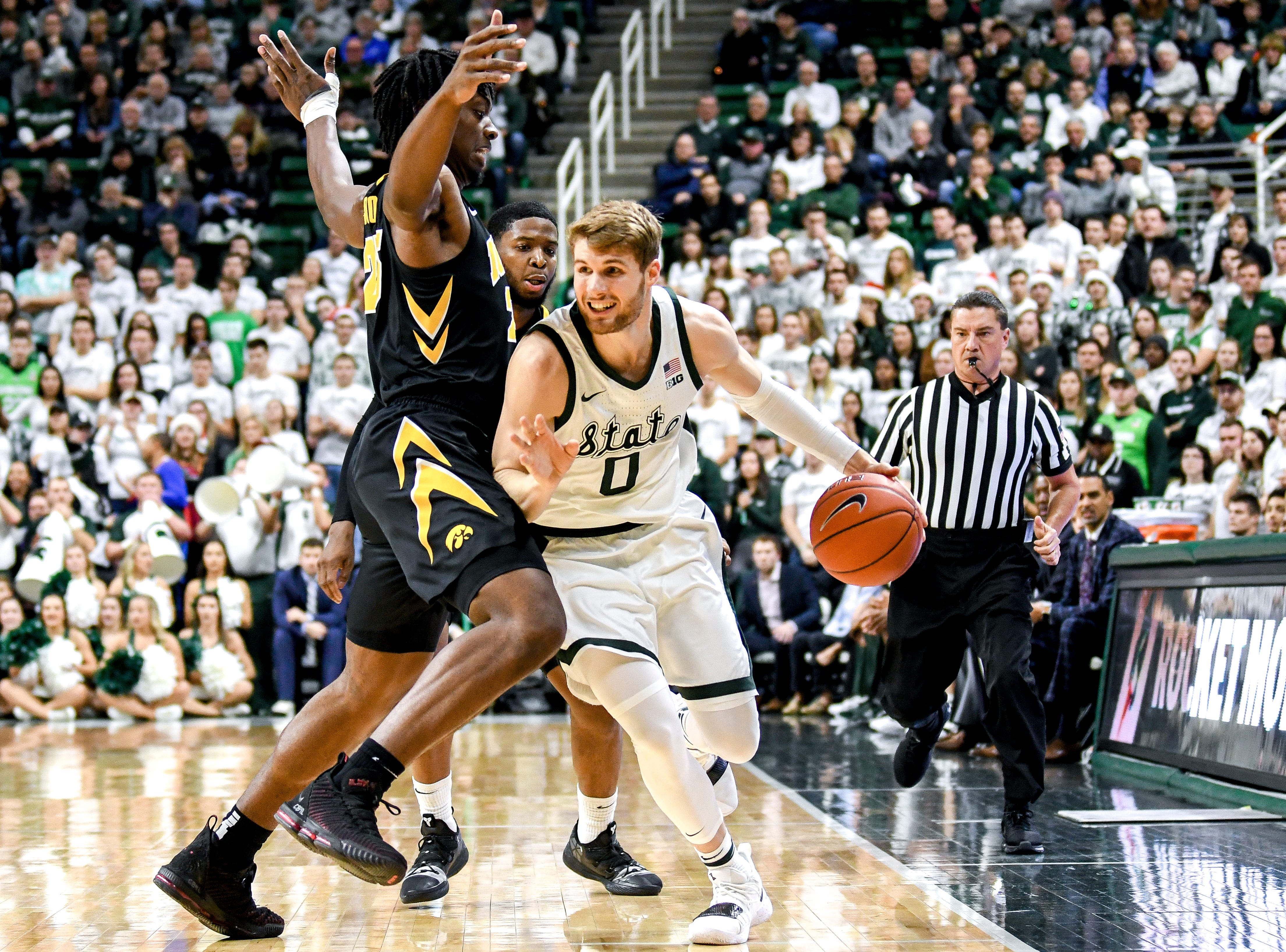 Michigan State's Kyle Ahrens, right, pushes pas Iowa's Tyler Cook during the first half on Monday, Dec. 3, 2018, at the Breslin Center in East Lansing.