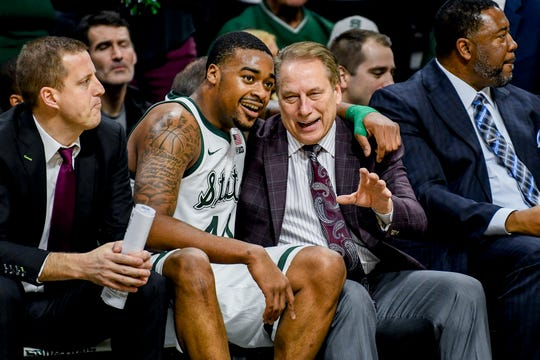 Michigan State coach Tom Izzo talks to Nick Ward during a game this season. To his left, assistant Dane Fife, who played for Bob Knight at Indiana. To his right, associate head coach Dwayne Stephens.