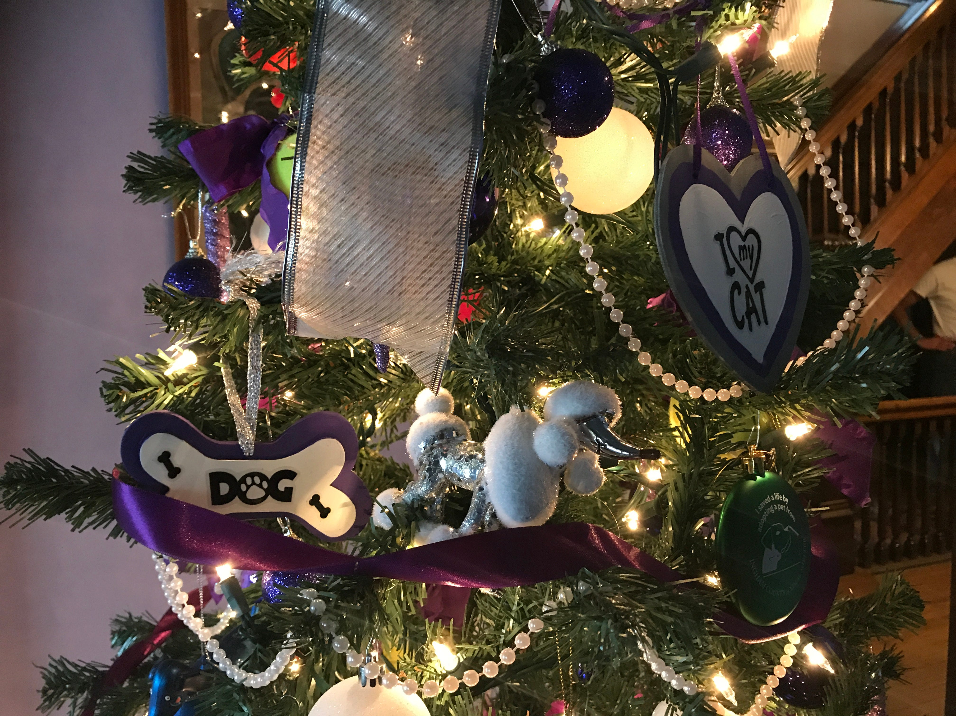 A silver and white poodle ornament on a Paws for Fun Christmas tree.