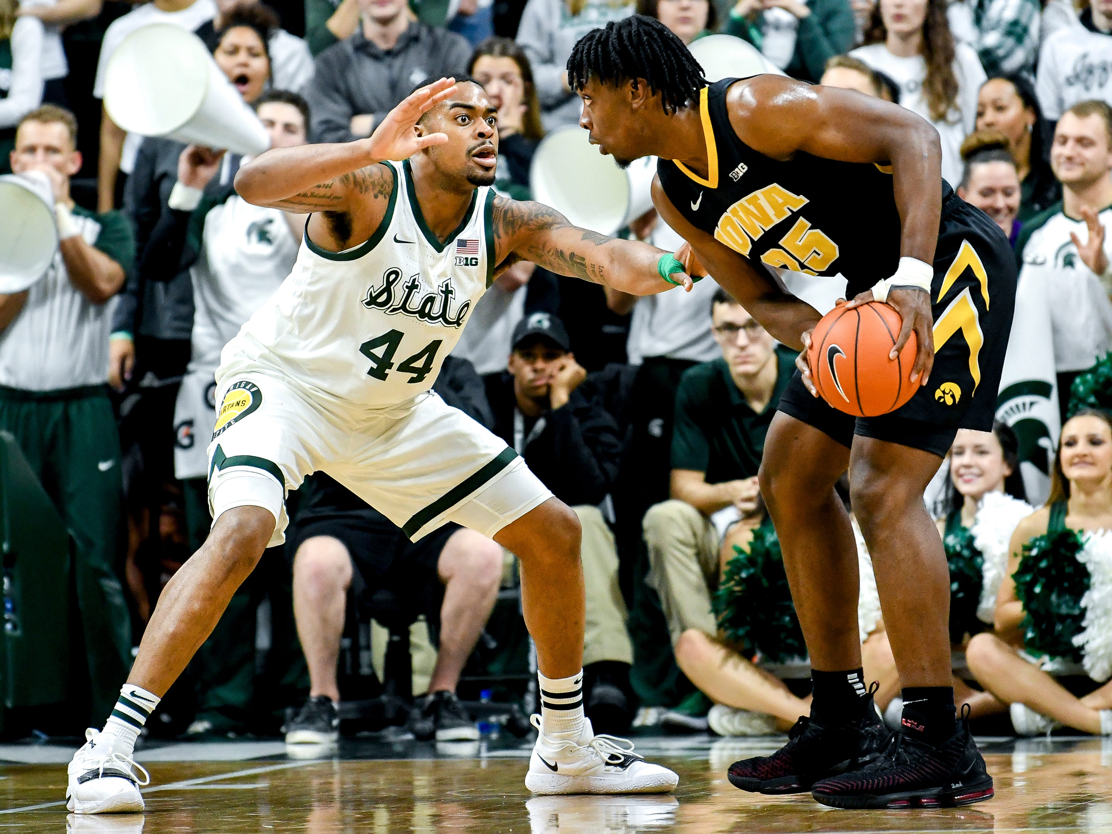 Michigan State's Nick Ward, left, defends Iowa's Tyler Cook during the first half on Monday, Dec. 3, 2018, at the Breslin Center in East Lansing.