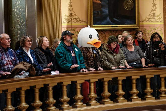 People line the Capitol Rotunda balcony protesting the lame duck legislation proposed by Republicans  Tuesday, Dec. 4, 2018.