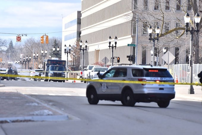 Lansing police and Michigan State Police investigate a suspicious package near a postal pick-up box near the U.S. Post Office on Townsend and Allegan.