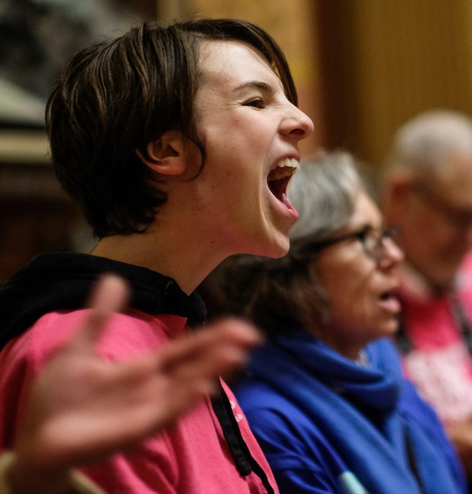 Emily Clancy from Hamtramck, leads a chant and yells loudly at a protest at the state Capitol Tuesday, Dec. 4, 2018. Around 200 people participated in the event protesting the lame duck legislation being considered by Republicans.