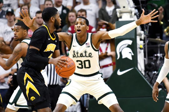 Michigan State's Marcus Bingham Jr., right, guards Iowa's Isaiah Moss during the second half on Monday, Dec. 3, 2018, at the Breslin Center in East Lansing. Michigan State beat Iowa 90-68.