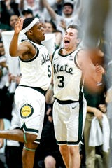 Michigan State's Cassius Winston, left, celebrates with teammate Foster Loyer after making a 3-poiner during the first half on Monday, Dec. 3, 2018, at the Breslin Center in East Lansing.
