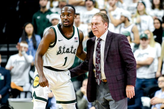 Michigan State's Joshua Langford, left, talks with head coach Tom Izzo during the first half on Monday, Dec. 3, 2018, at the Breslin Center in East Lansing.