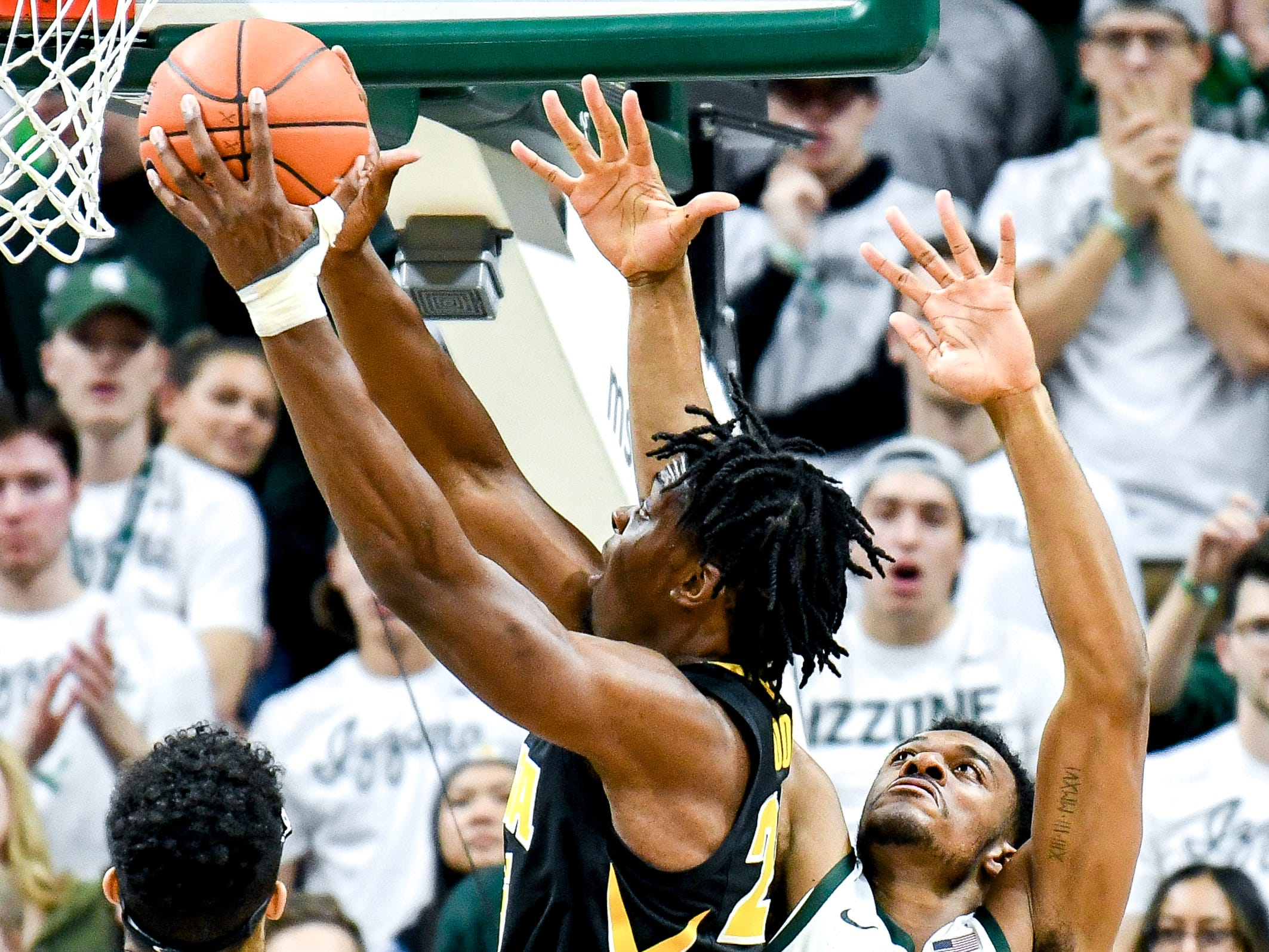 Michigan State's Xavier Tillman, right, defends as Iowa's Tyler Cook shoots during the first half on Monday, Dec. 3, 2018, at the Breslin Center in East Lansing.