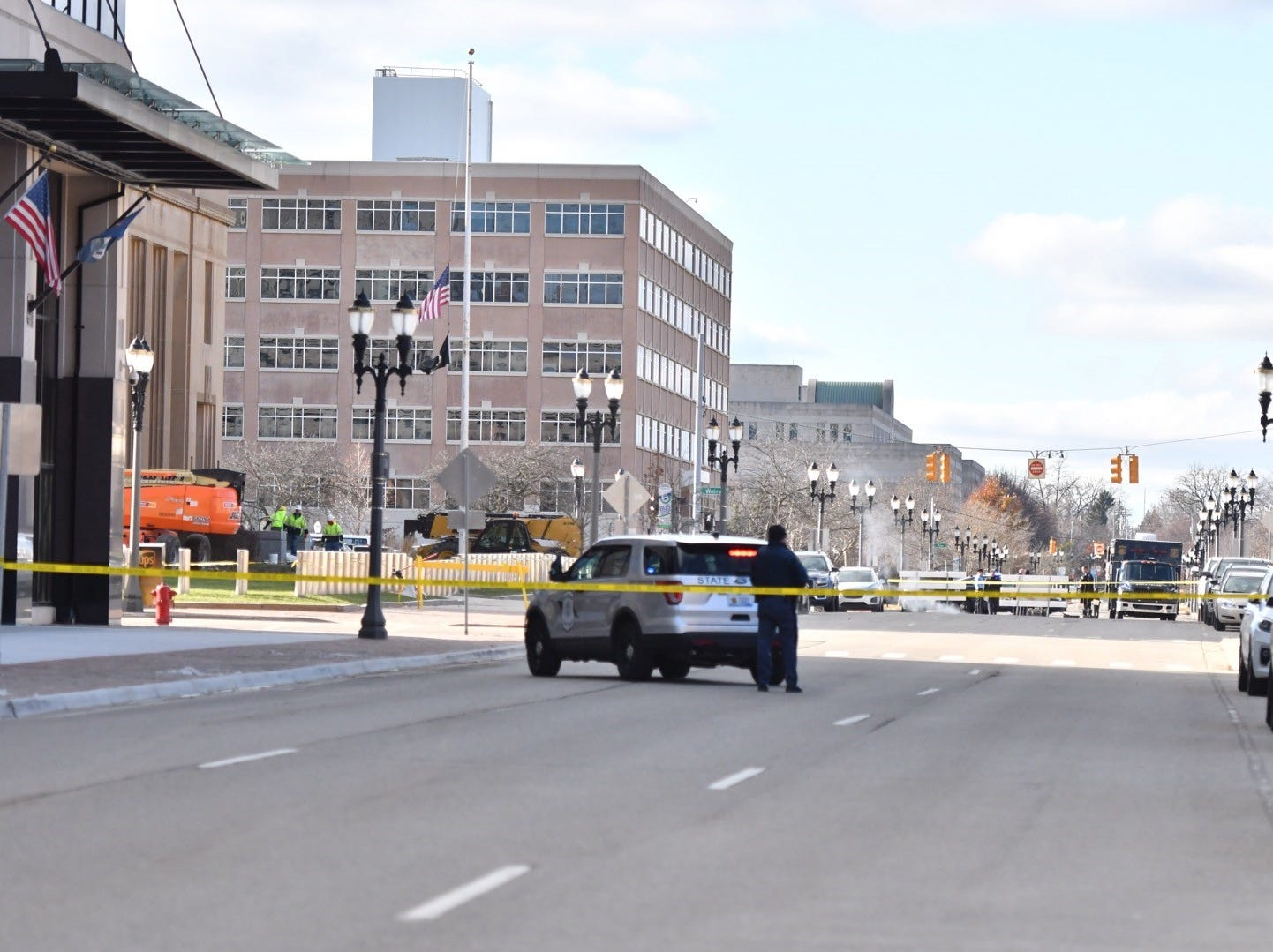 Lansing police and Michigan State Police block streets as they investigate a suspicious package near a postal pick-up box near the U.S. Post Office on Townsend and Allegan.