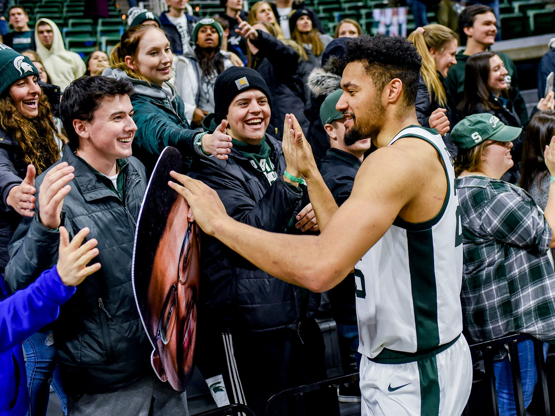 Michigan State's Kenny Goins celebrates with fans after the game on Monday, Dec. 3, 2018, at the Breslin Center in East Lansing. Michigan State beat Iowa 90-68.