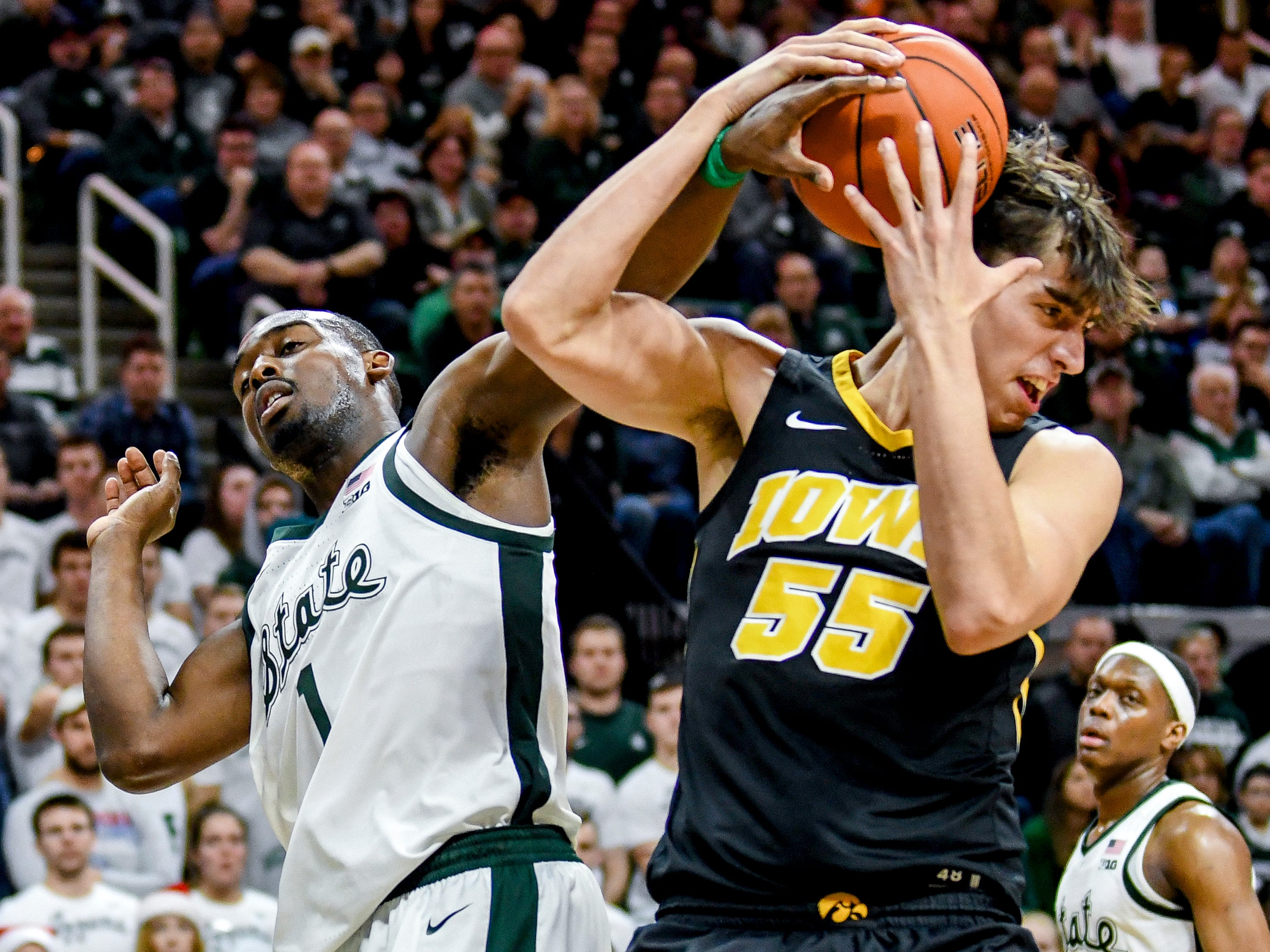 Michigan State's Joshua Langford, left, gets tangled up with Iowa's Luka Garza during the second half on Monday, Dec. 3, 2018, at the Breslin Center in East Lansing. Michigan State beat Iowa 90-68.